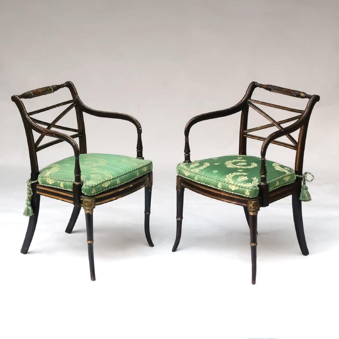 PAIR REGENCY PARCEL-GILT EBONIZED ARMCHAIRS