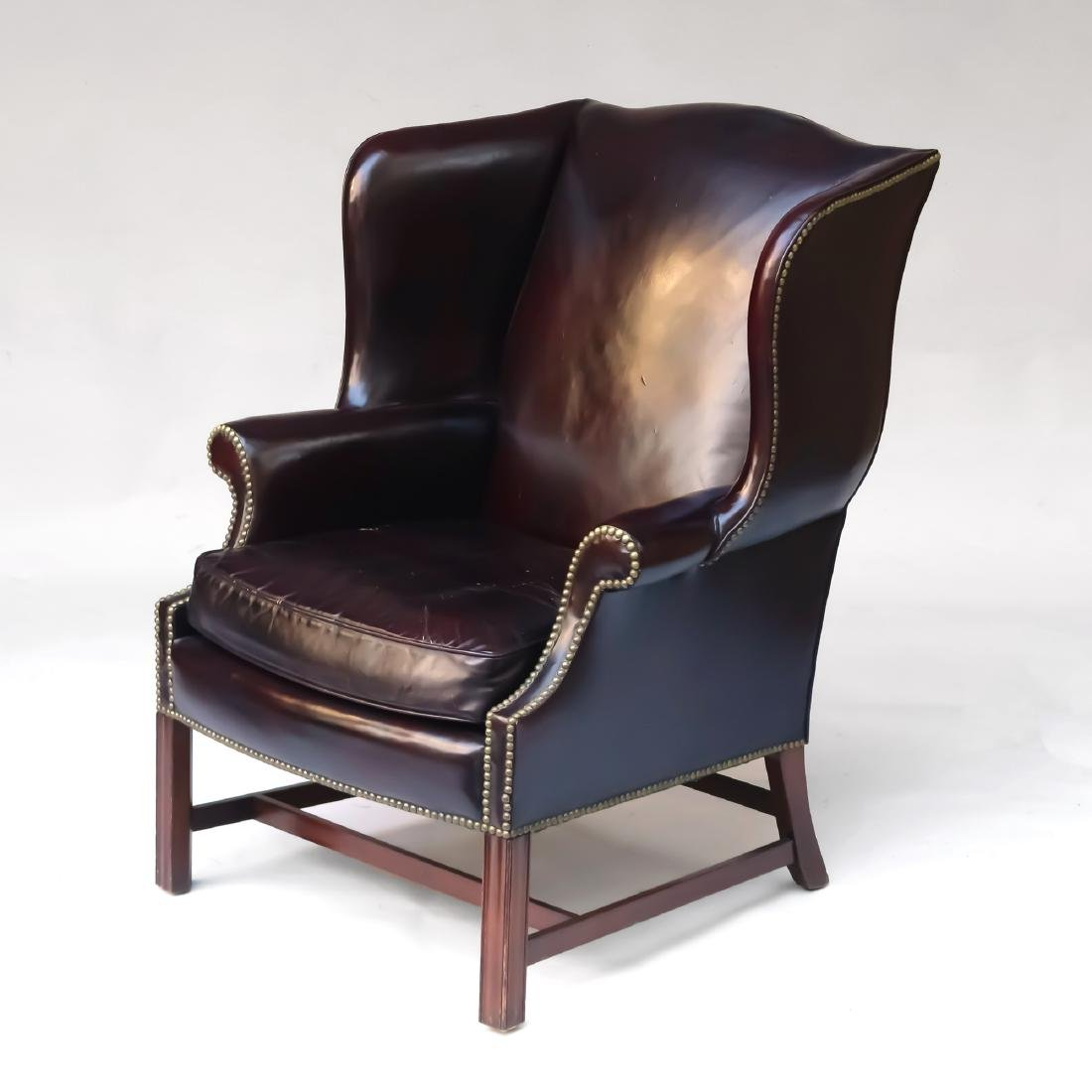 LEATHER CHIPPENDALE-STYLE WING CHAIR