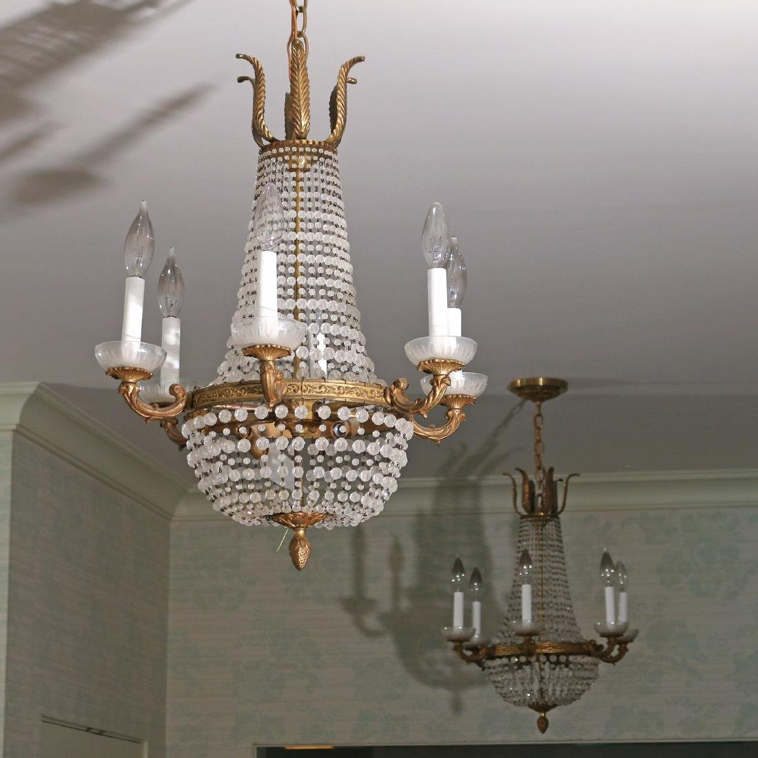 PAIR ORMOLU AND GLASS CHANDELIERS