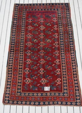 15) SEMI ANTIQUE RUG, ROWS OF FLOWERHEADS, DATED