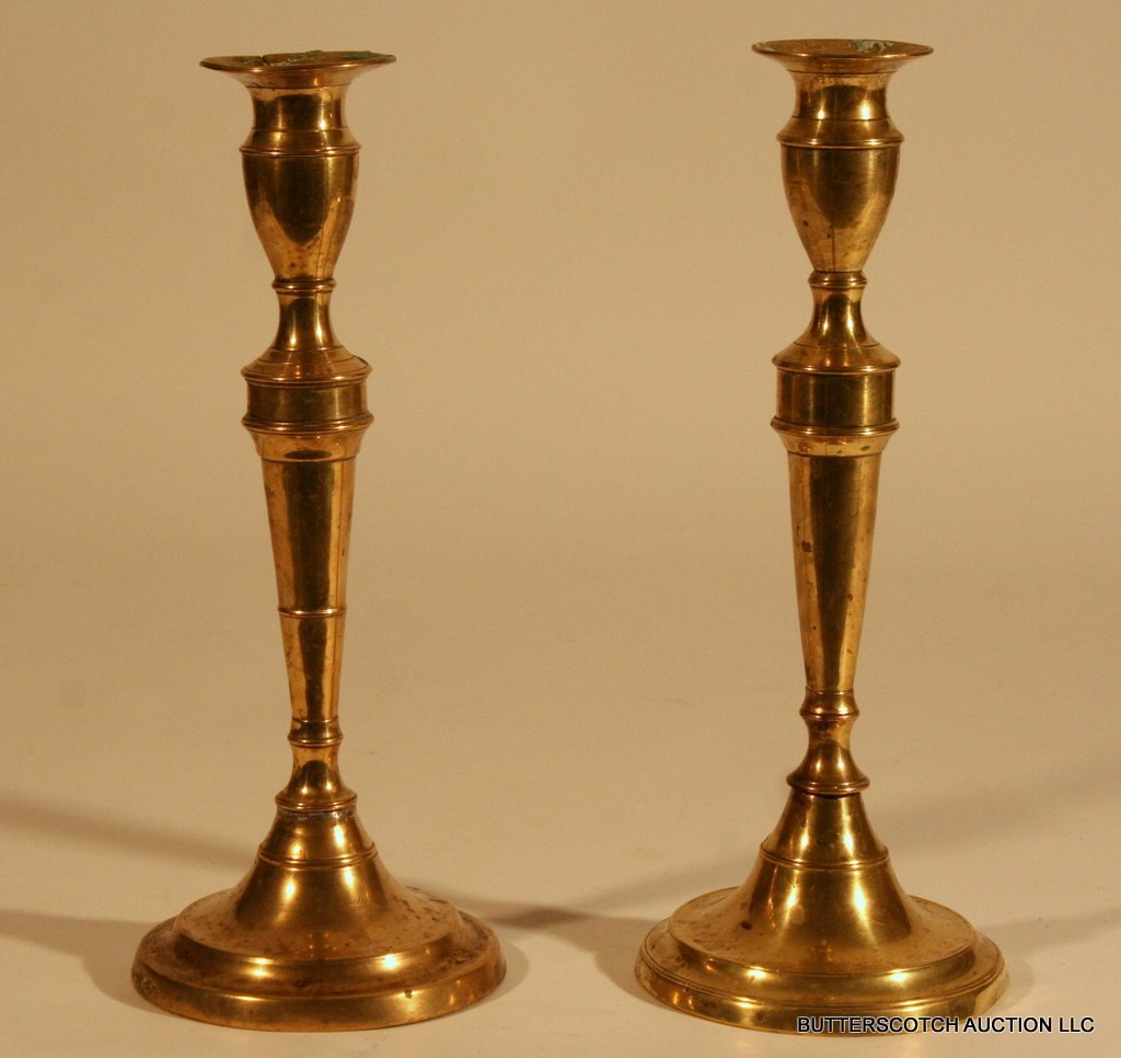 24:  PAIR GEORGIAN BRASS CANDLESTICKS,