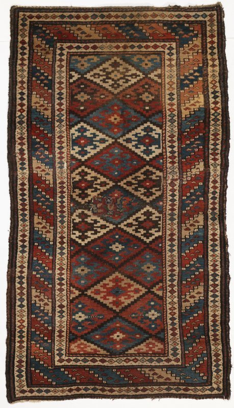 "L.19TH C. CAUCASIAN RUG, 5' 11"" x 3' 5"", with patch and"