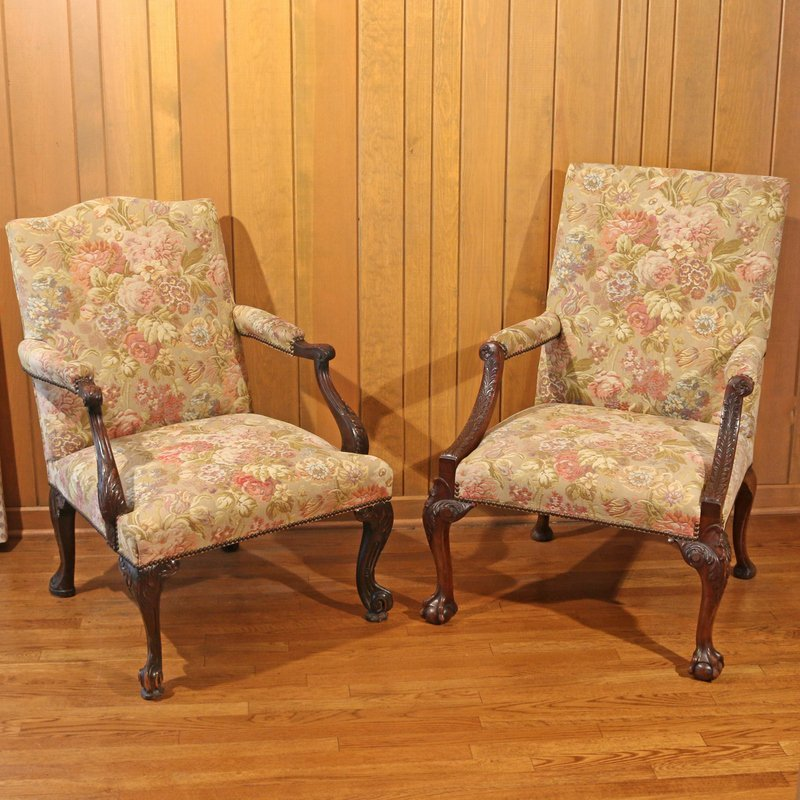 TWO SIMILAR GEORGIAN STYLE LIBRARY CHAIRS