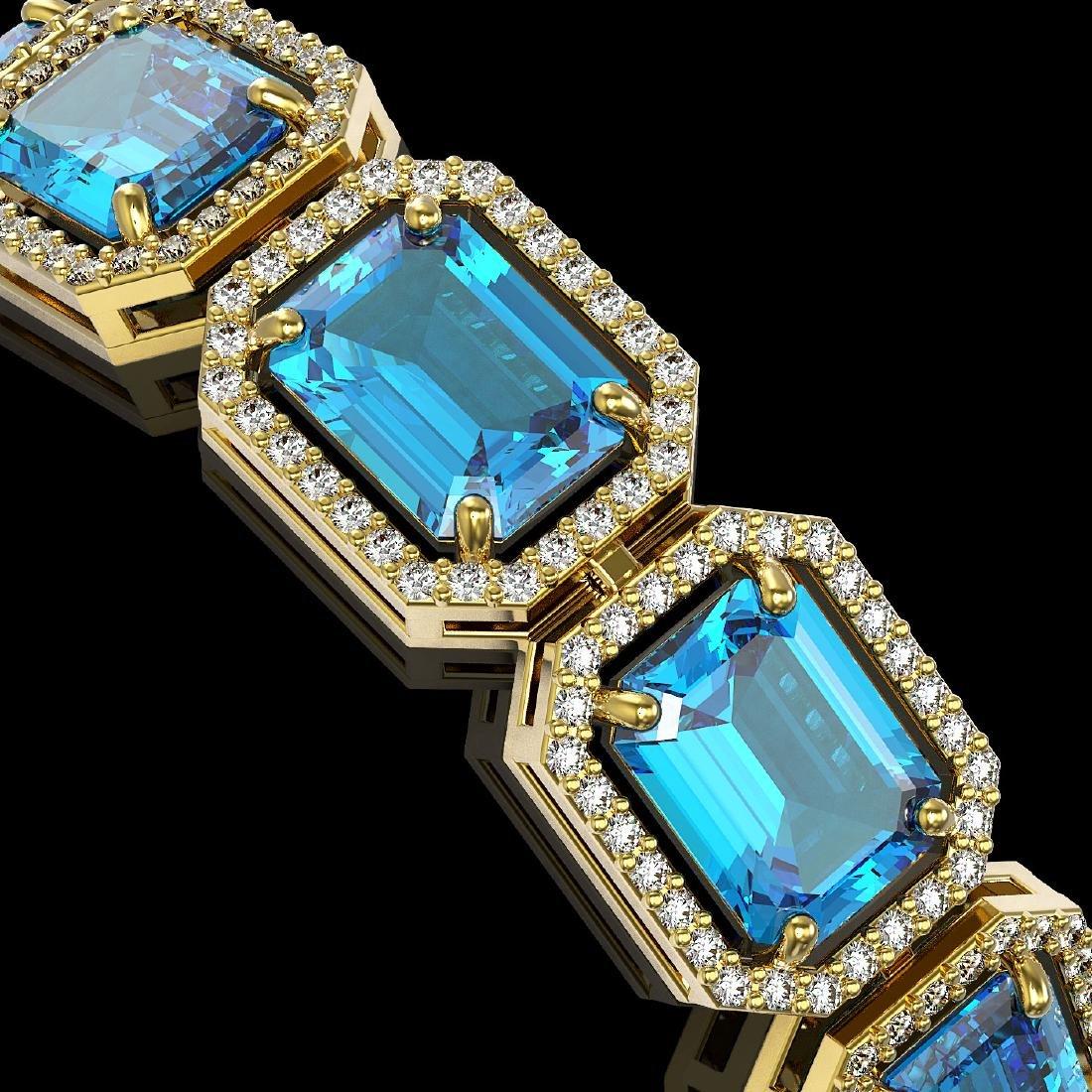 35.61 CTW Swiss Topaz & Diamond Halo Bracelet 10K - 3