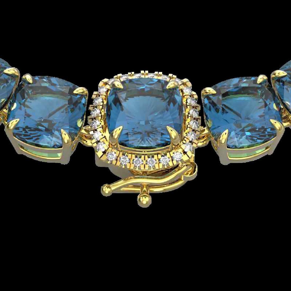 87 CTW London Blue Topaz & VS/SI Diamond Halo Micro