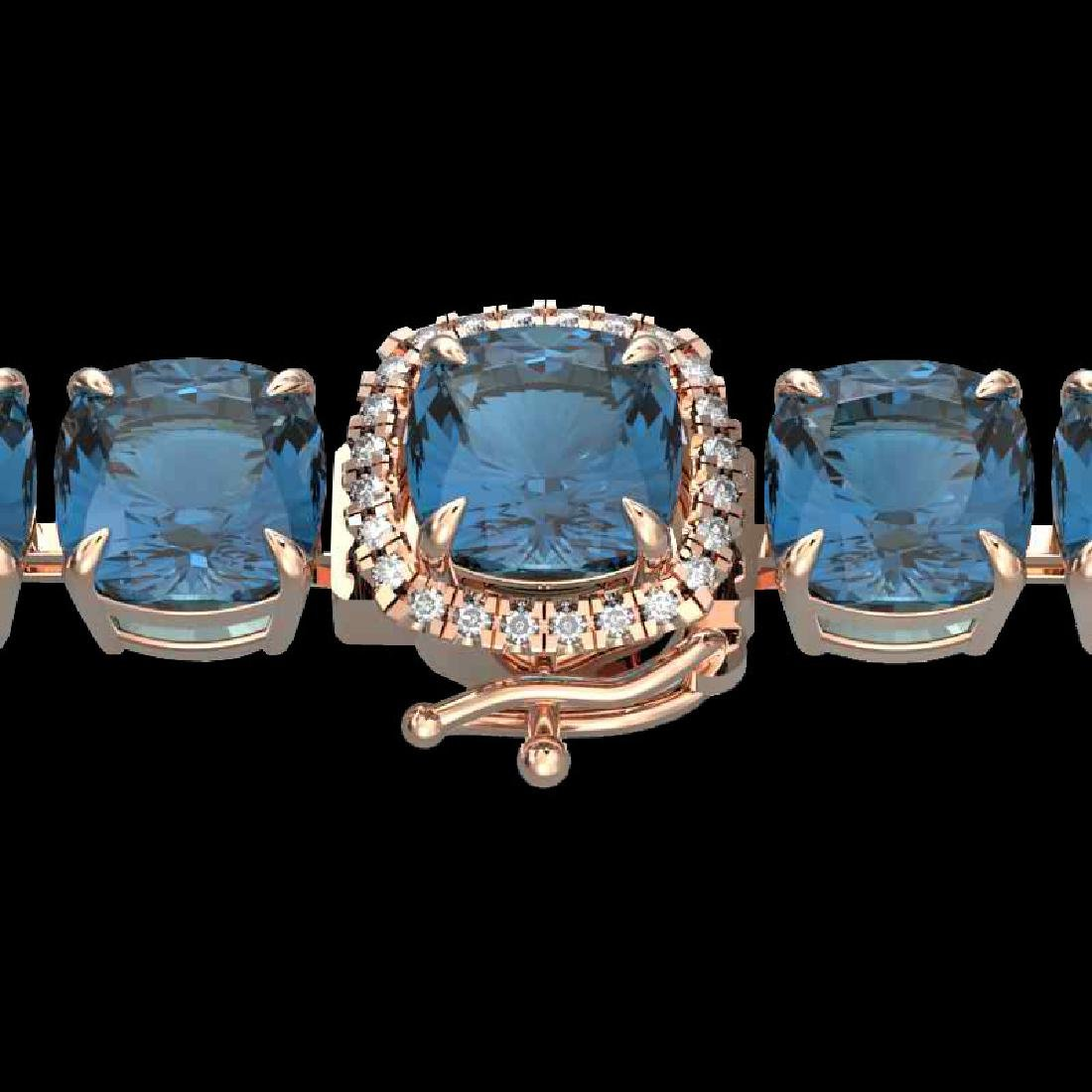 35 CTW London Blue Topaz & Micro VS/SI Diamond Halo