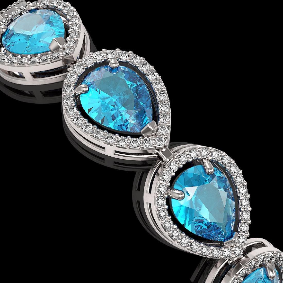 20.3 CTW Swiss Topaz & Diamond Halo Bracelet 10K White - 3