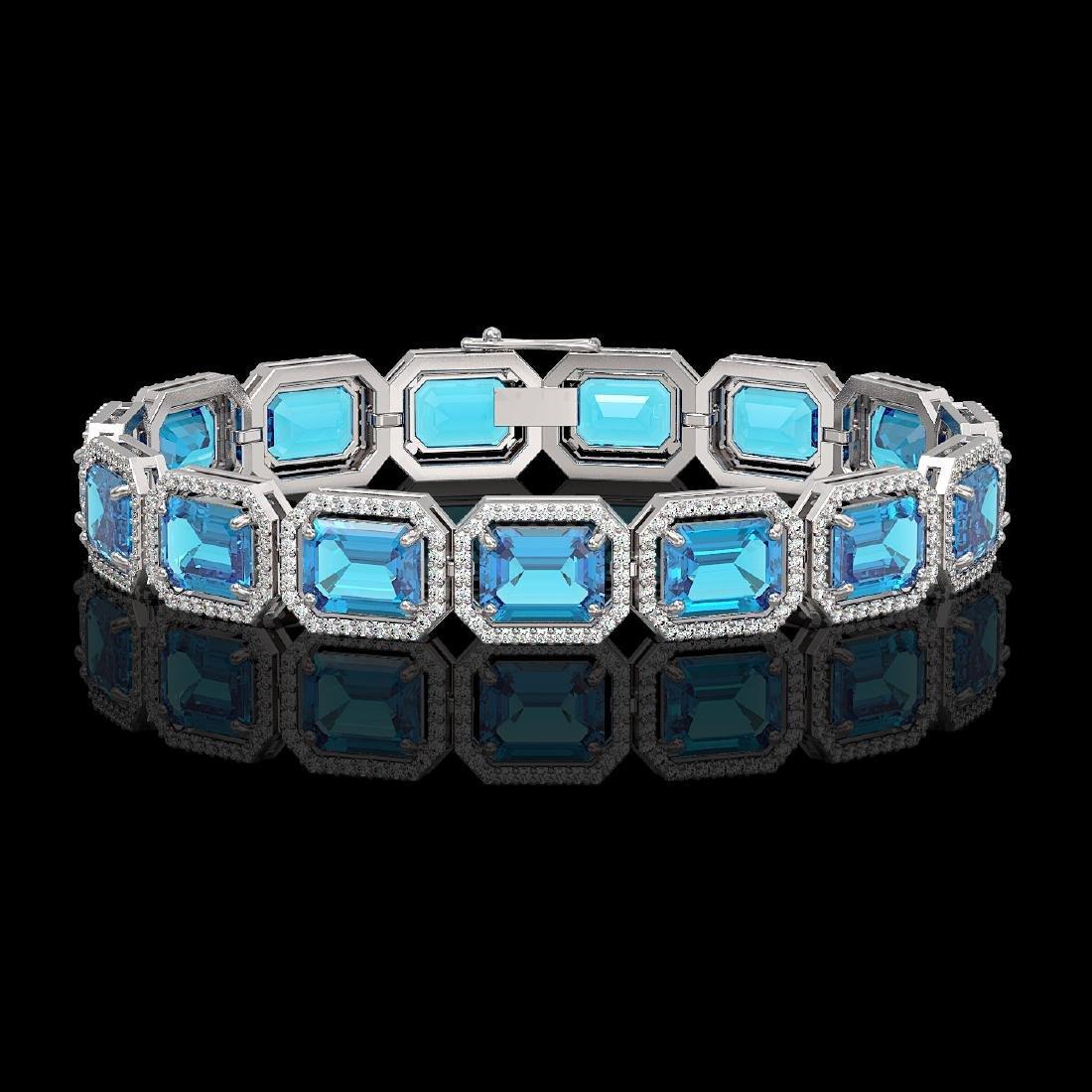 35.61 CTW Swiss Topaz & Diamond Halo Bracelet 10K White