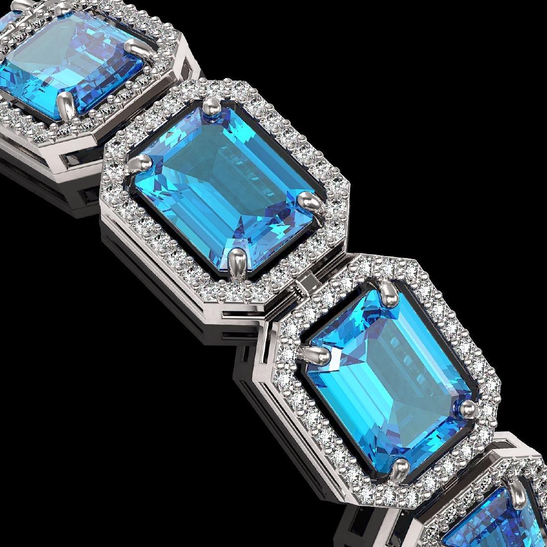 35.61 CTW Swiss Topaz & Diamond Halo Bracelet 10K White - 3