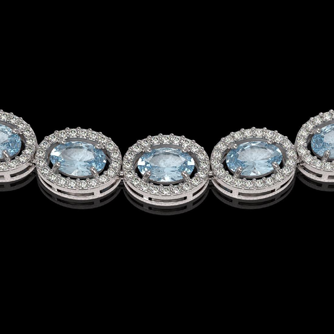 33.25 CTW Sky Topaz & Diamond Halo Necklace 10K White - 3
