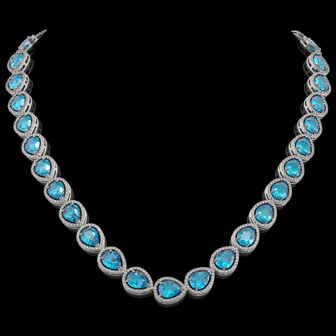 43.2 CTW Swiss Topaz & Diamond Halo Necklace 10K White