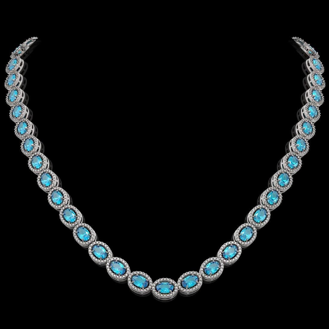 33.25 CTW Swiss Topaz & Diamond Halo Necklace 10K White