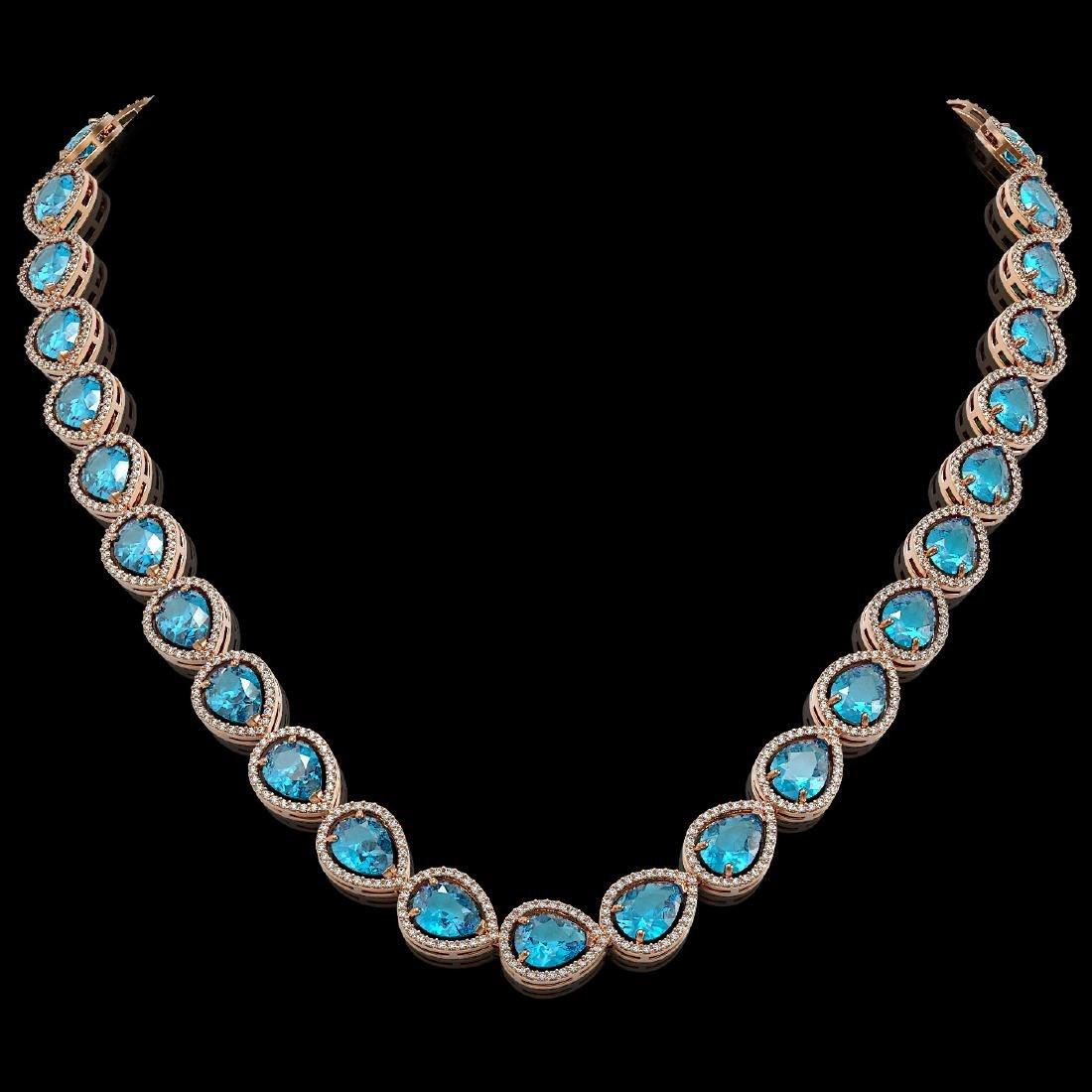 43.2 CTW Swiss Topaz & Diamond Halo Necklace 10K Rose
