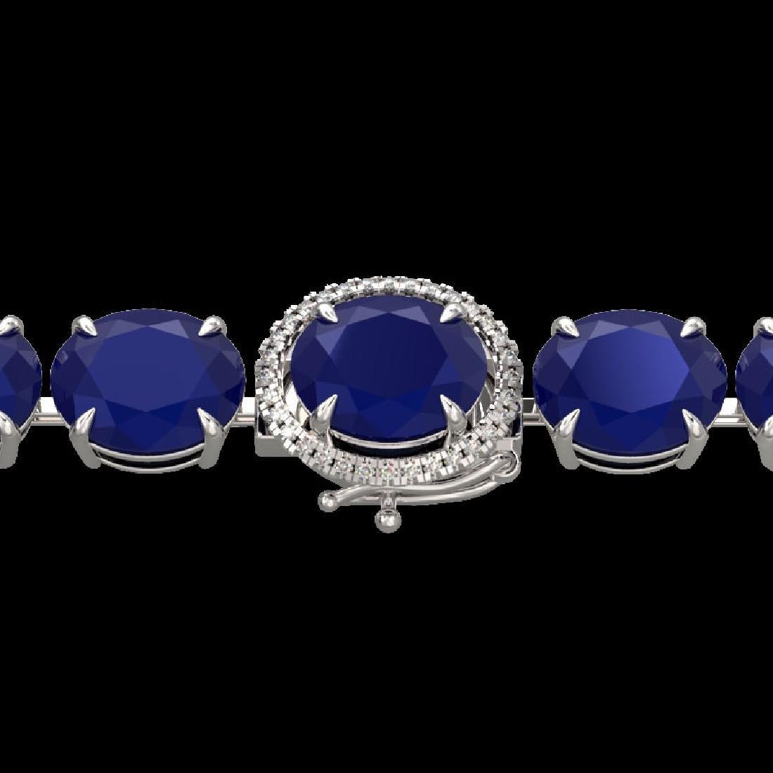 76 CTW Sapphire & Micro Pave VS/SI Diamond Halo