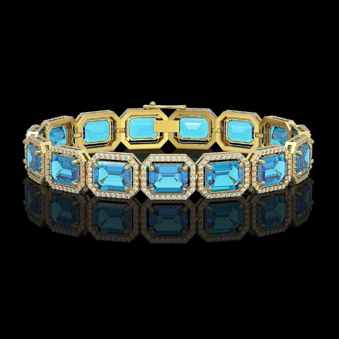 35.61 CTW Swiss Topaz & Diamond Halo Bracelet 10K