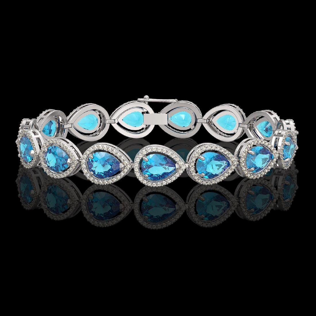 20.3 CTW Swiss Topaz & Diamond Halo Bracelet 10K White