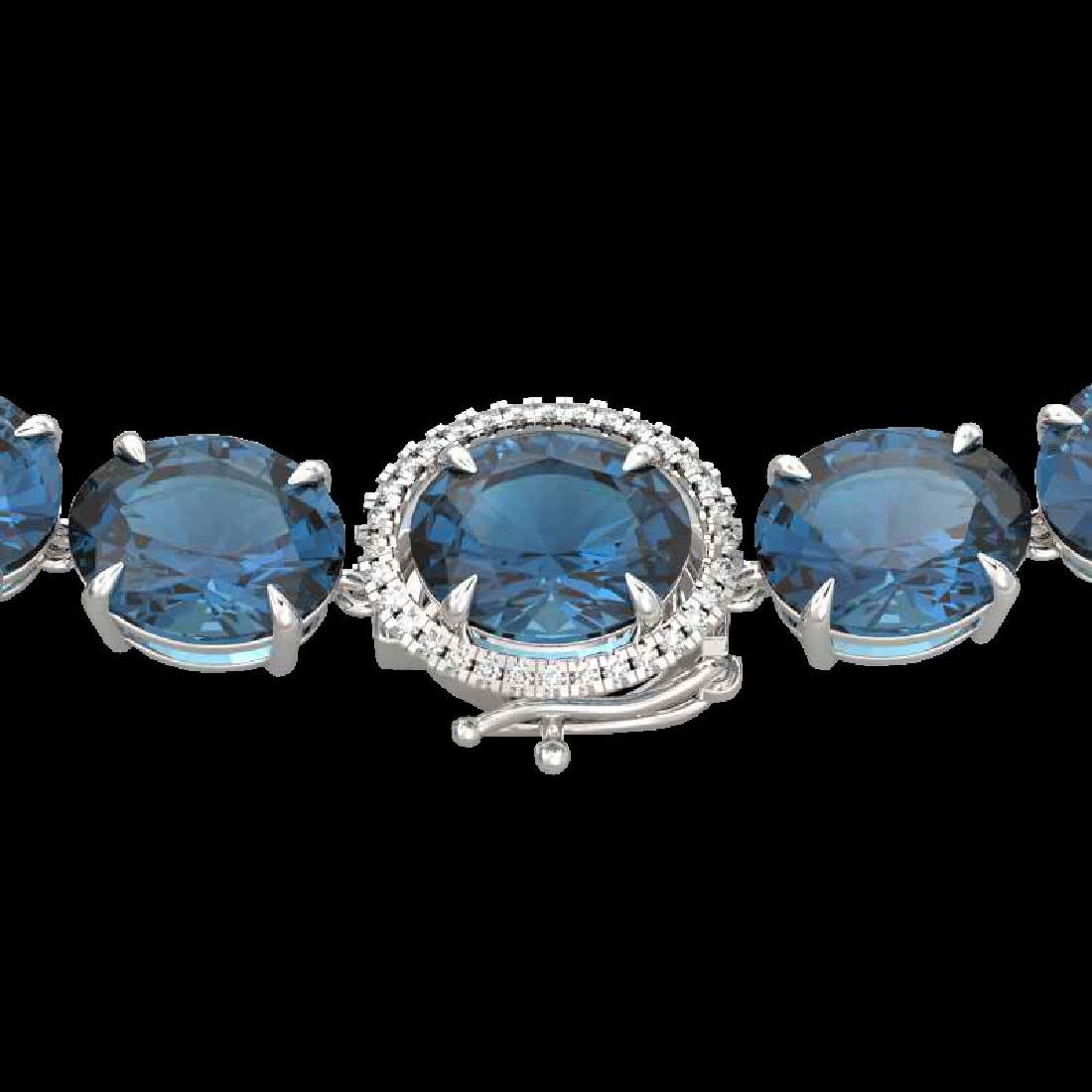 177 CTW London Blue Topaz & VS/SI Diamond Halo Micro