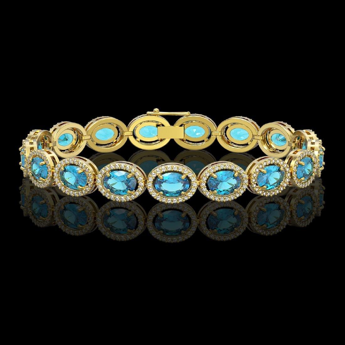 24.32 CTW Swiss Topaz & Diamond Halo Bracelet 10K