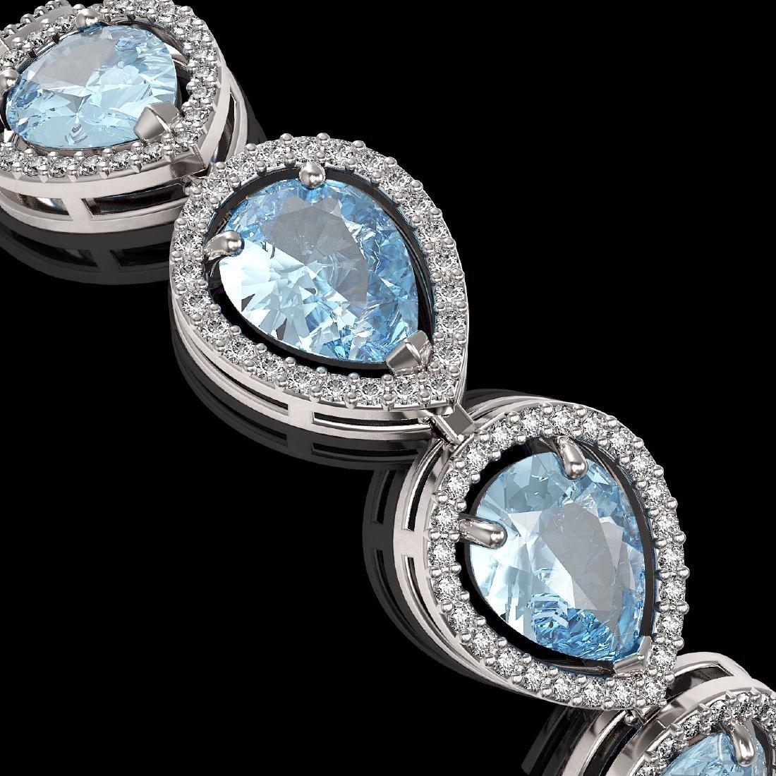 19.55 CTW Sky Topaz & Diamond Halo Bracelet 10K White - 3