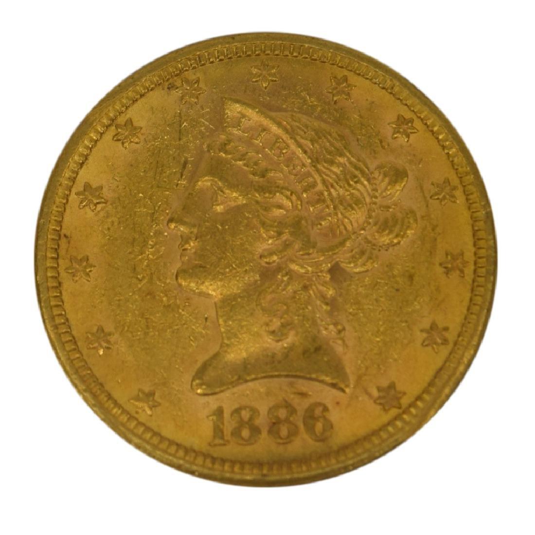 1886-S LIBERTY EAGLE $10 GOLD COIN NGC AU58