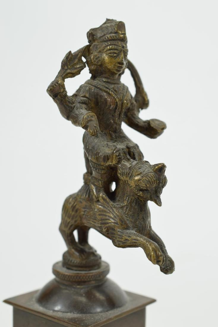 18TH C. BRONZE KRISHNA RIDING ON LION W/ SWORD