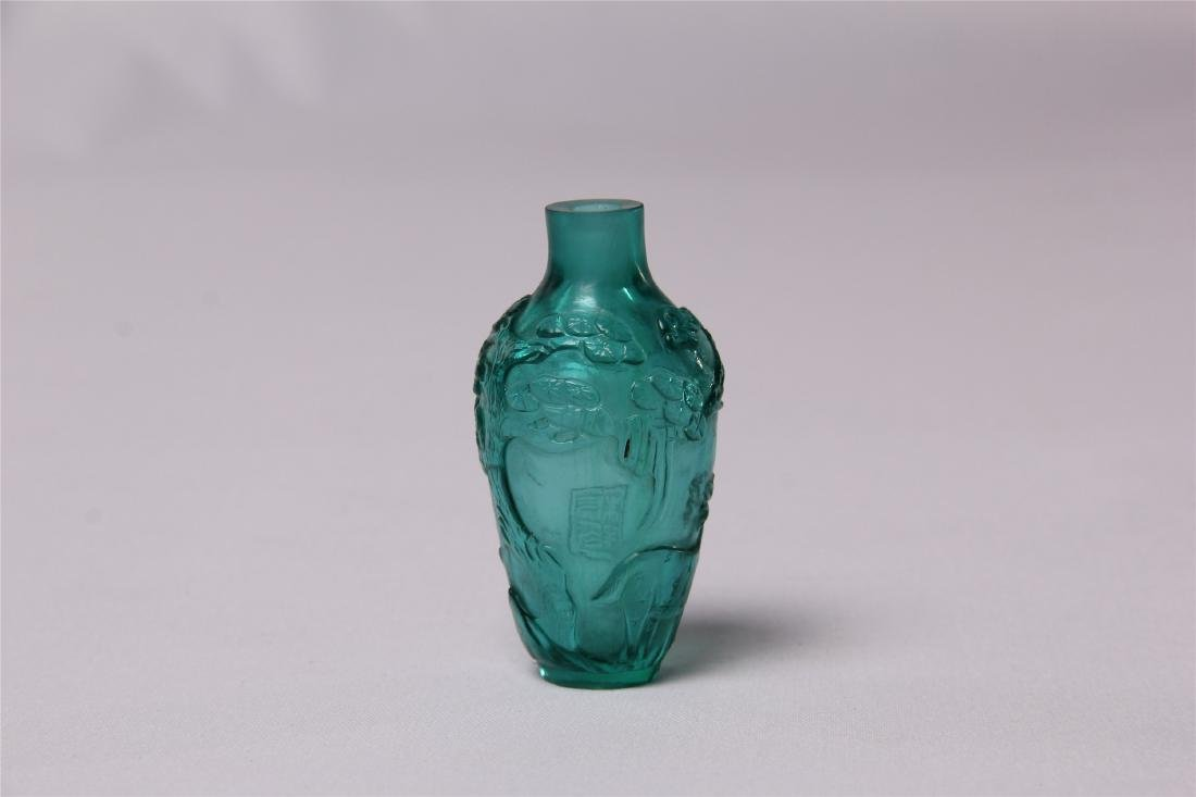 CHINESE BLUE GLASS CRAVED SNUFF BOTTLE