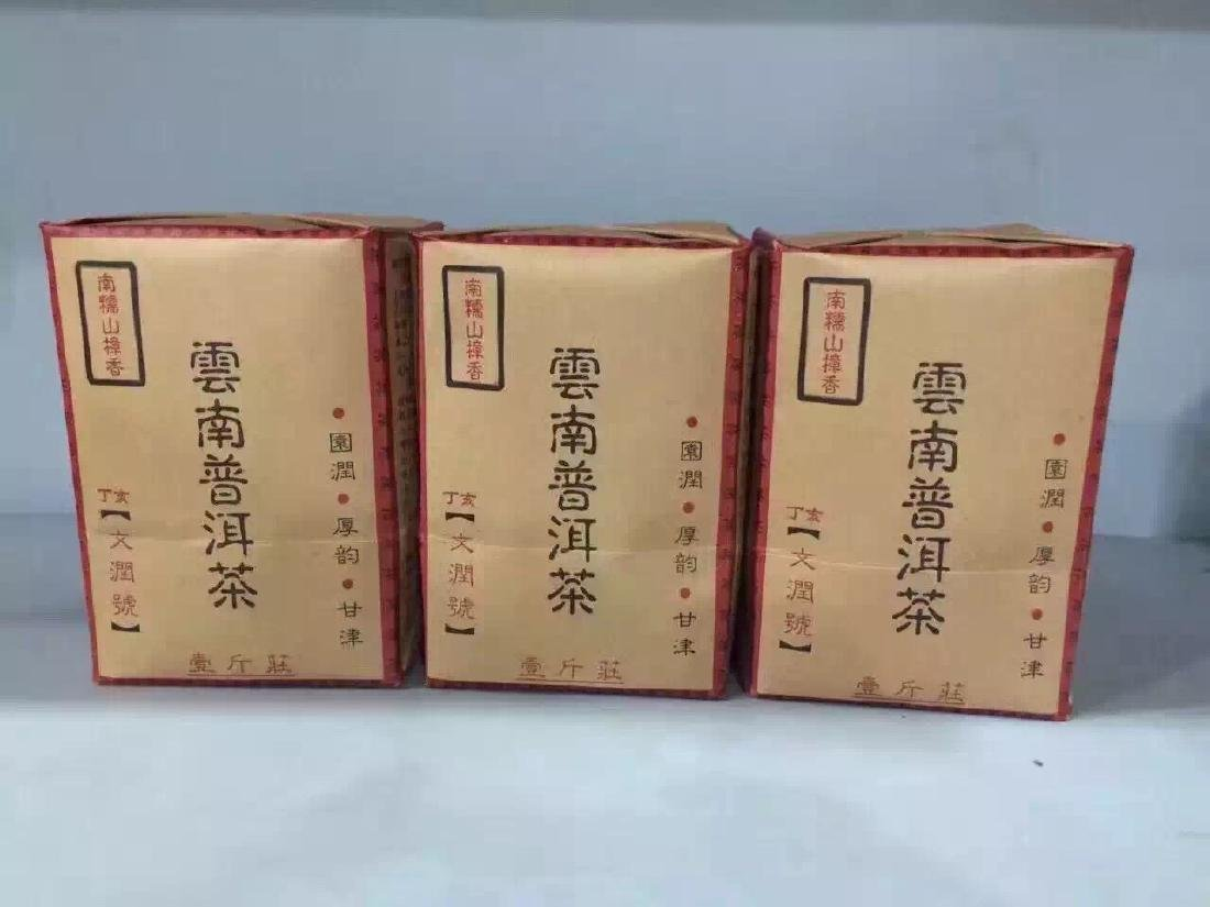 THREE PACKS OF CHINESE PU'ER TEA Y2000 1.5 KG