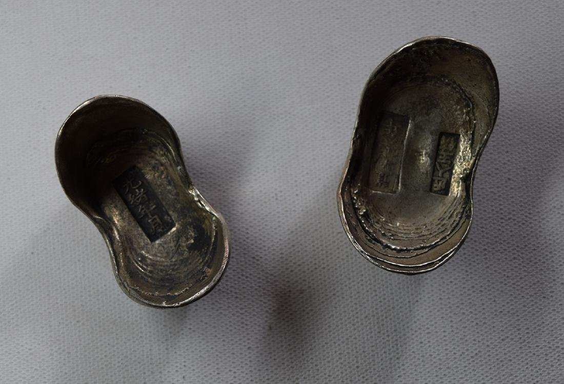 TWO CHINESE SILVER INGOTS