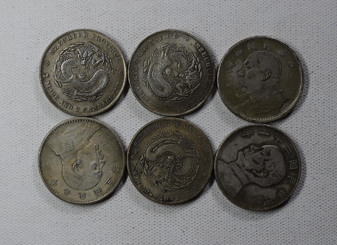 SIX CHINESE DOLLAR COINS - 2