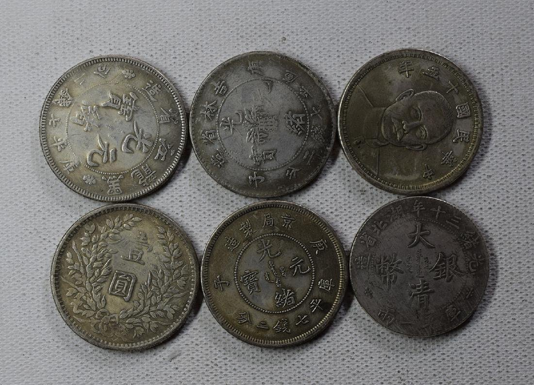 SIX CHINESE DOLLAR COINS