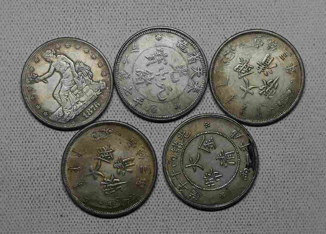FIVE CHINESE DOLLAR COINS