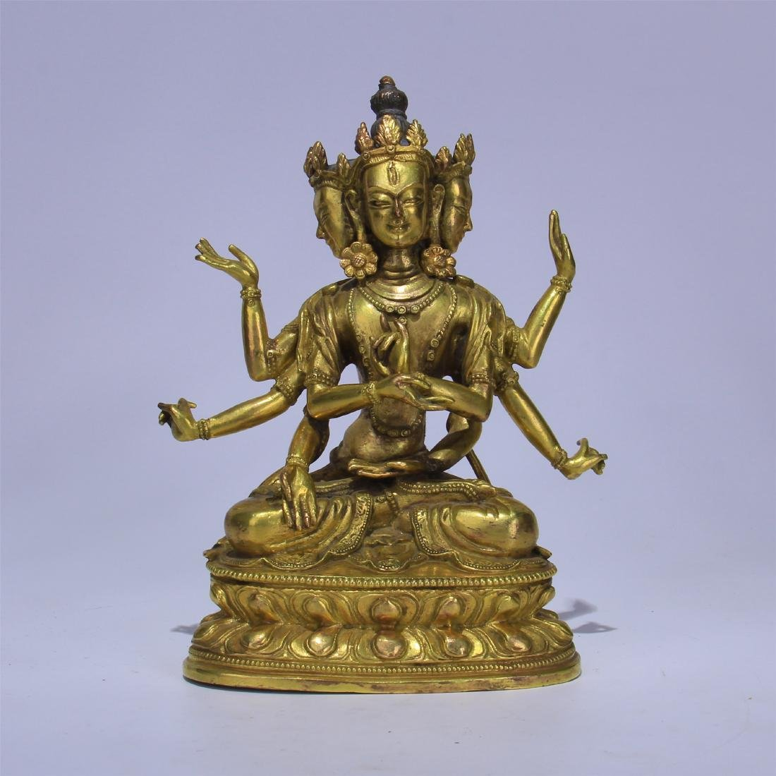 CHINESE GILT BRONZE SEATED THREE FACE SIX ARMS GUANYIN