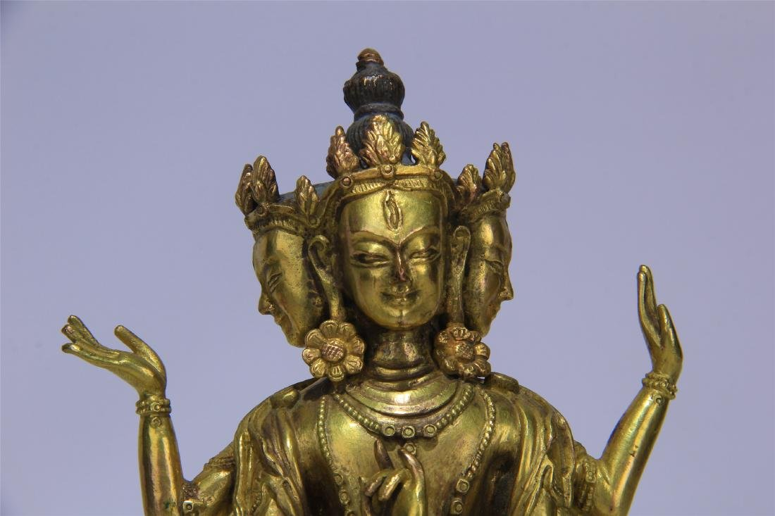 CHINESE GILT BRONZE SEATED THREE FACE SIX ARMS GUANYIN - 2