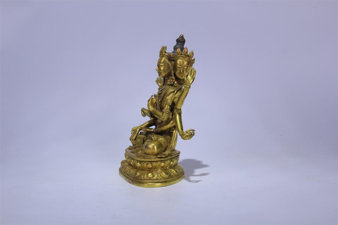 CHINESE GILT BRONZE SEATED THREE FACE SIX ARMS GUANYIN - 3