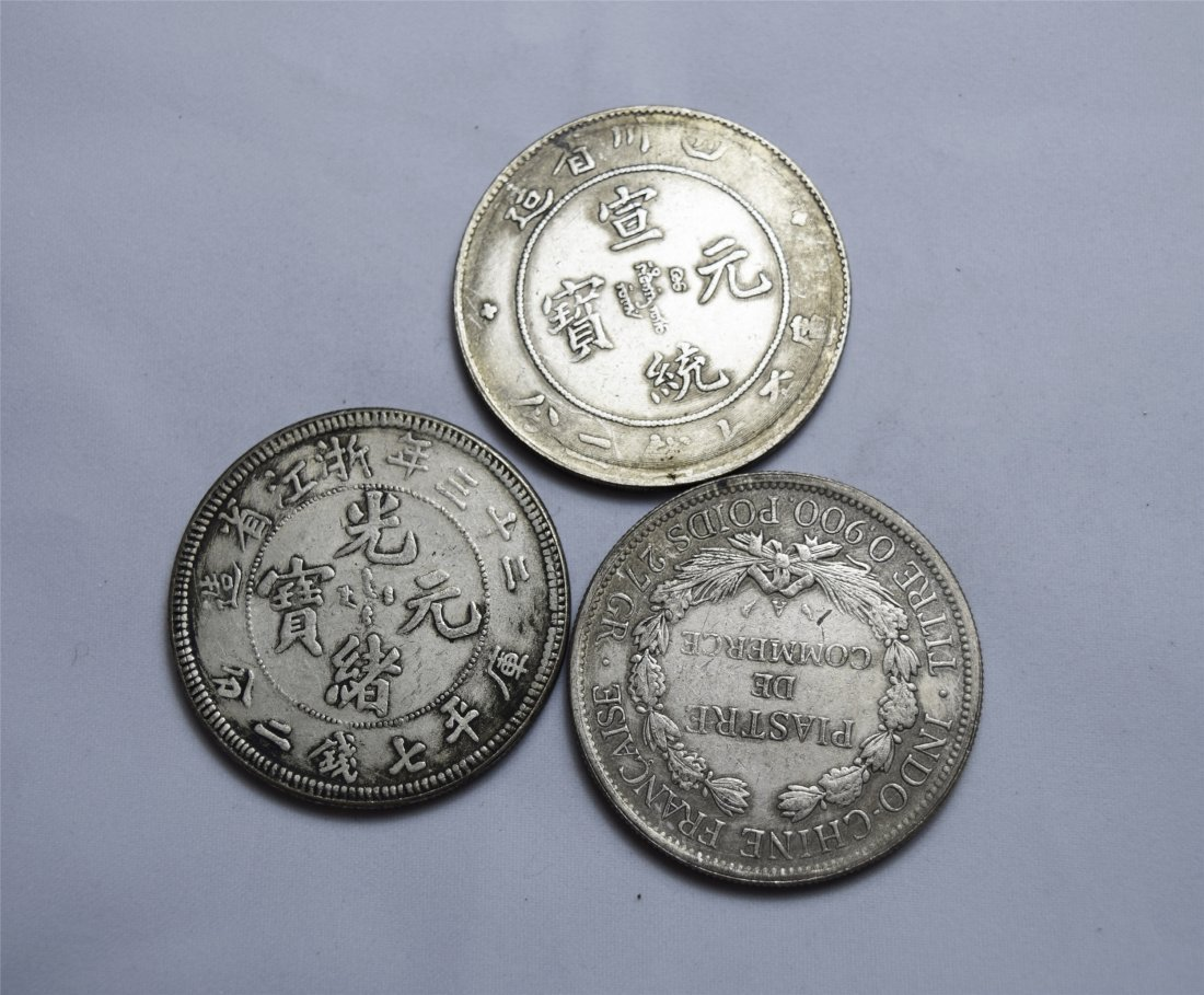 THREE CHINESE SILVER DOLLAR COINS - 2