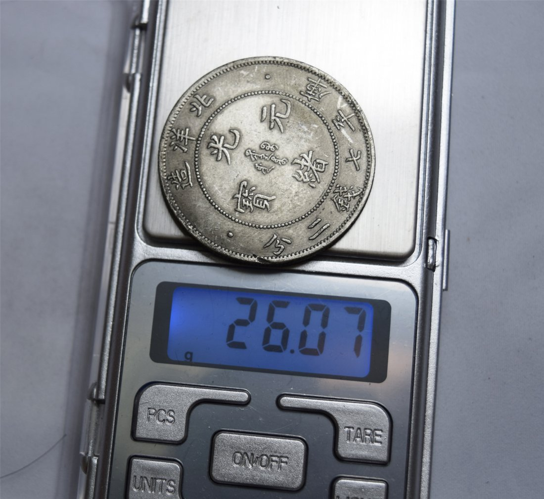 THREE CHINESE SILVER DOLLAR COINS - 3