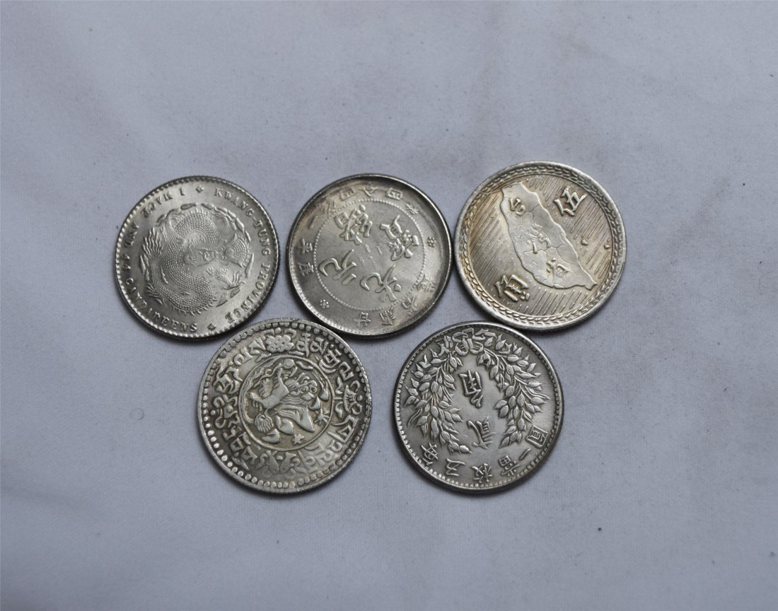 FIVE CHINESE SILVER COINS 20 CENT