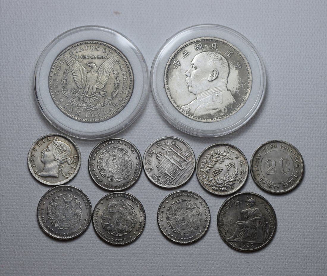 ELEVEEN CHINESE SILVER COINS