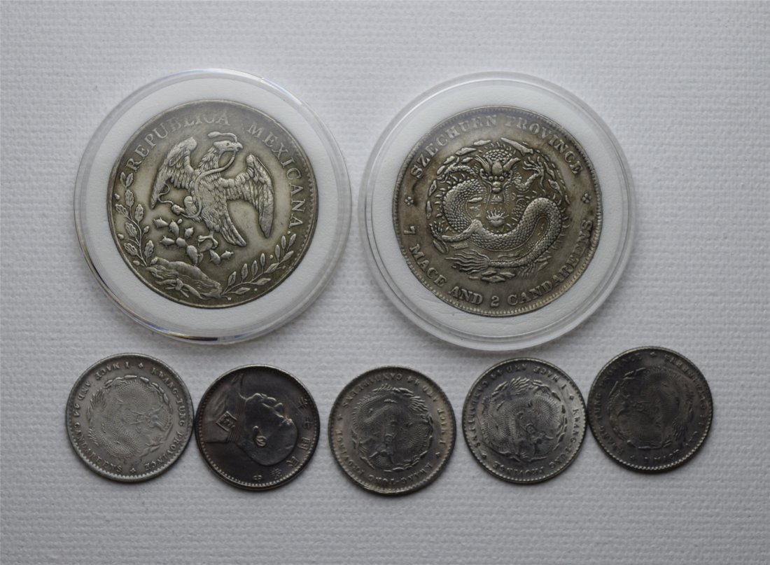 SEVEN CHINESE SILVER COINS