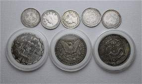 EIGHT CHINESE SILVER COINS