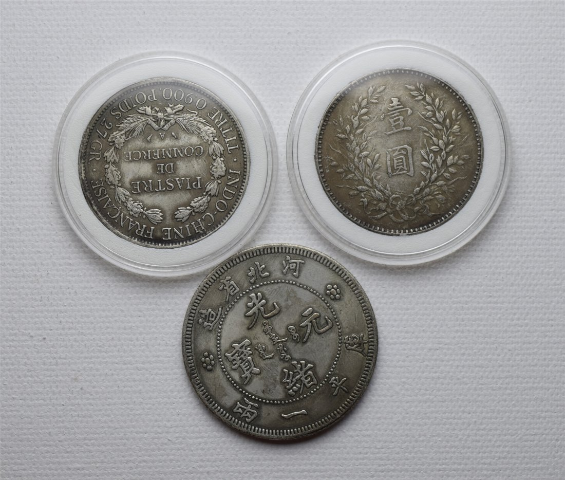 THREE CHINESE DOLLAR SILVER COINS