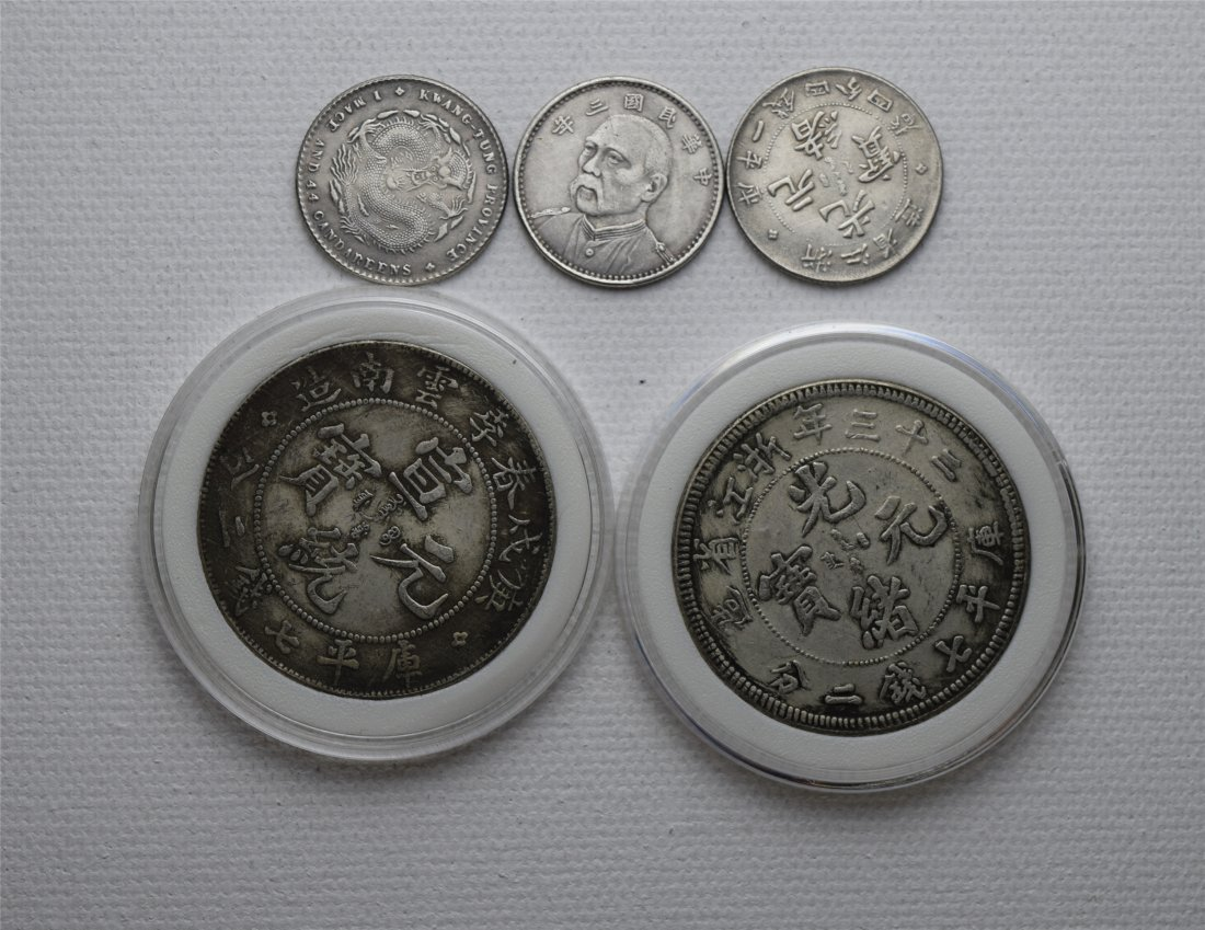 FIVE CHINESE SILVER COINS