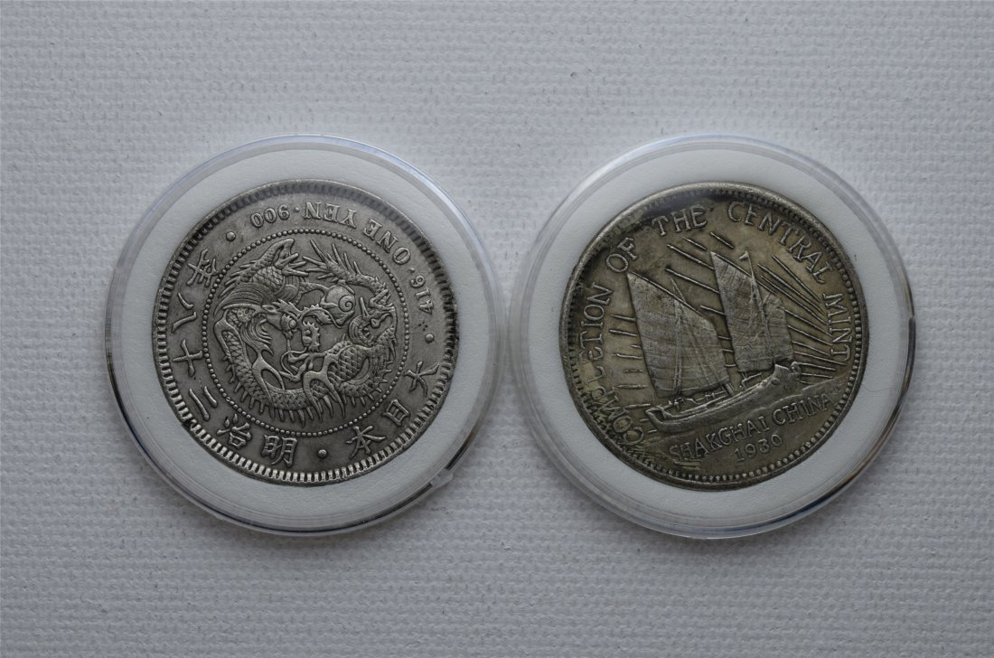 TWO ASIAN SILVER DOLLAR COINS