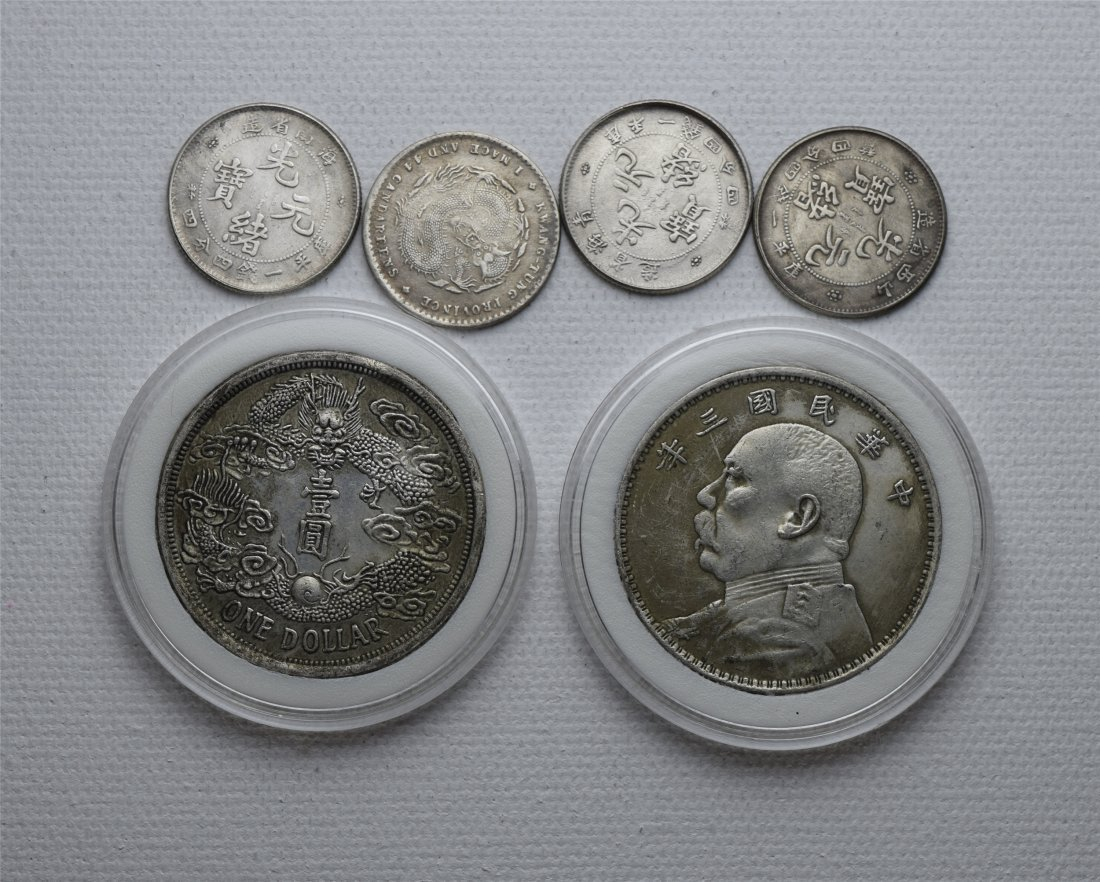 SIX CHINESE SILVER COINS