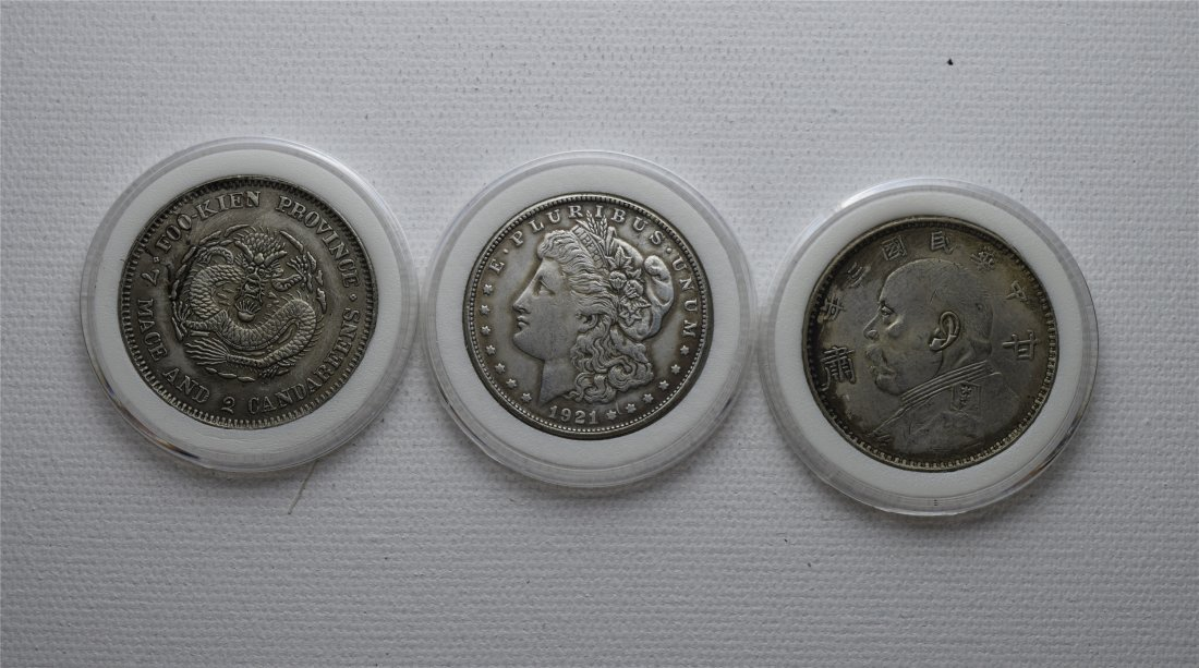 THREE CHINESE SILVER DOLLAR COINS