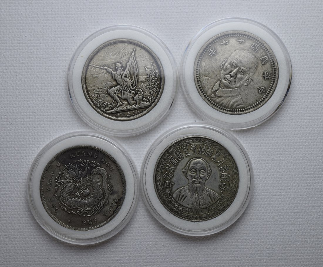 FOUR CHINESE SILVER DOLLAR COINS