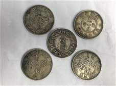 FIVE CHINESE SILVER DOLLAR COINS