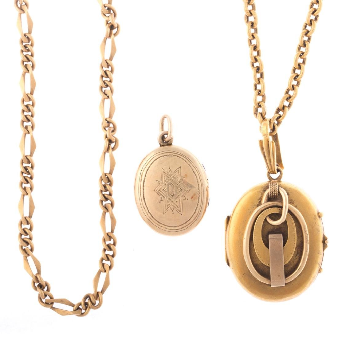 A Pair of Lockets Accompanied by Chains