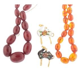 A Pair of Amber Necklaces and Cloisonne Charms