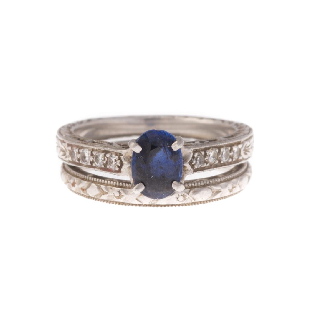 A Platinum Sapphire Engagement Ring with Band